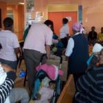Our-Volunteers-sharing-donations-at-Delft-Clinic-2.jpg