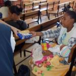 Our-Volunteers-sharing-donations-at-Delft-Clinic-4.jpg
